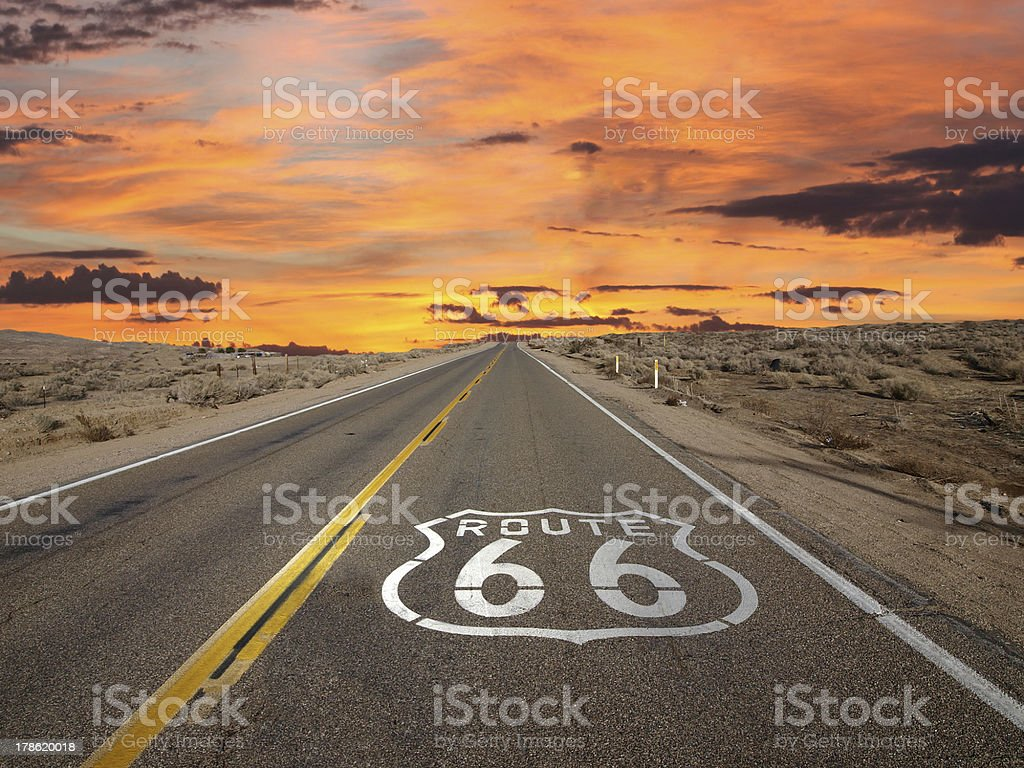 Route 66 Pavement Sign Sunrise Mojave Desert stock photo