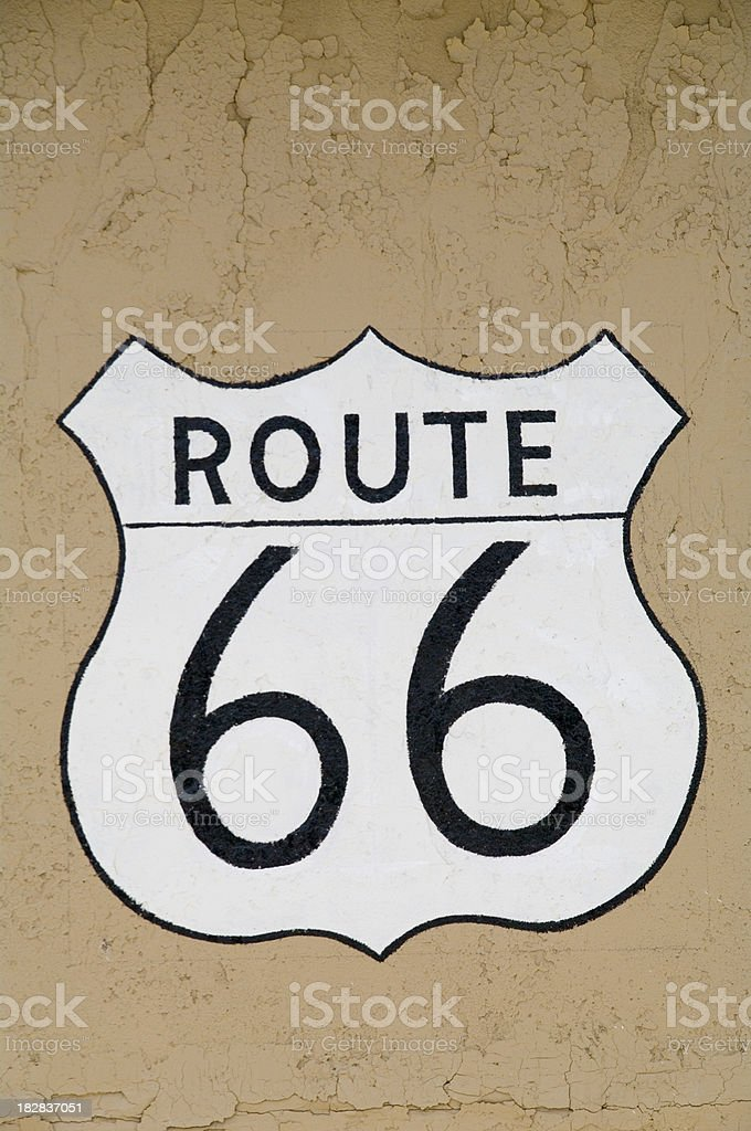 Route 66: Road Sign on Brown Grungy Wall royalty-free stock photo
