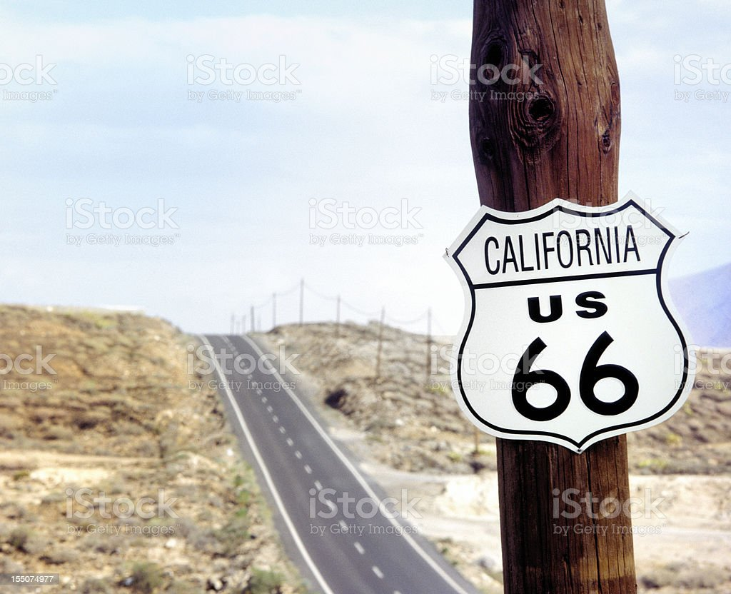 route 66 road sign on wooden pole stock photo