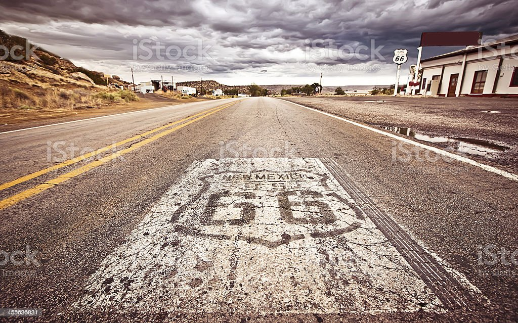 Route 66 shield painted on road stock photo