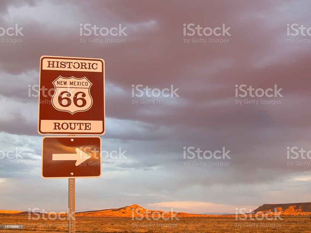 route 66 sign and desert sunset landscape royalty-free stock photo