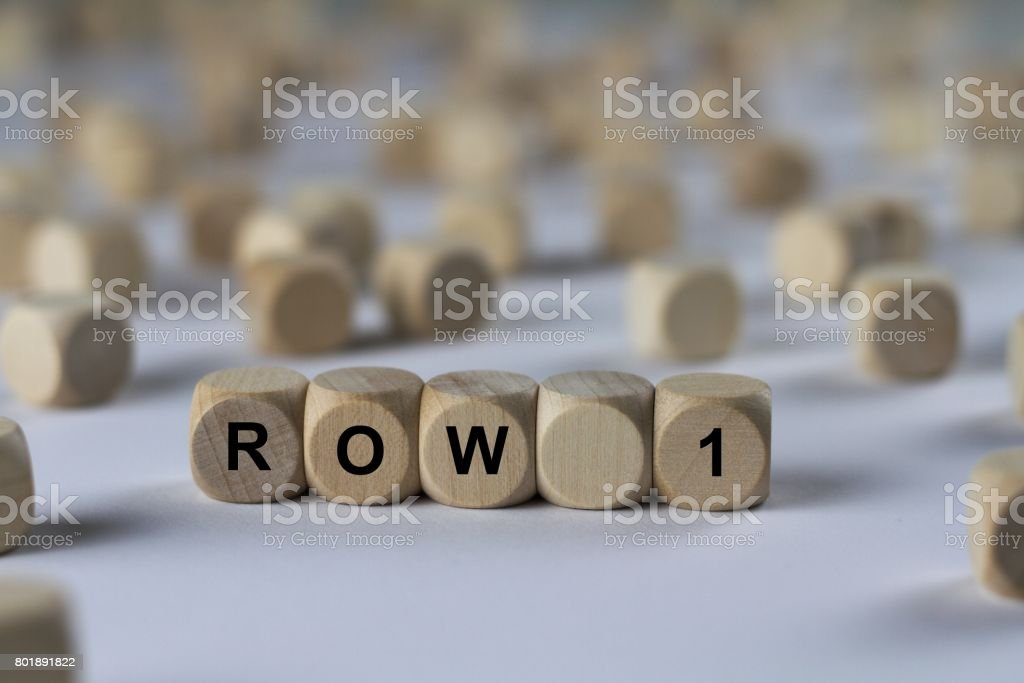 row 1 - cube with letters, sign with wooden cubes stock photo