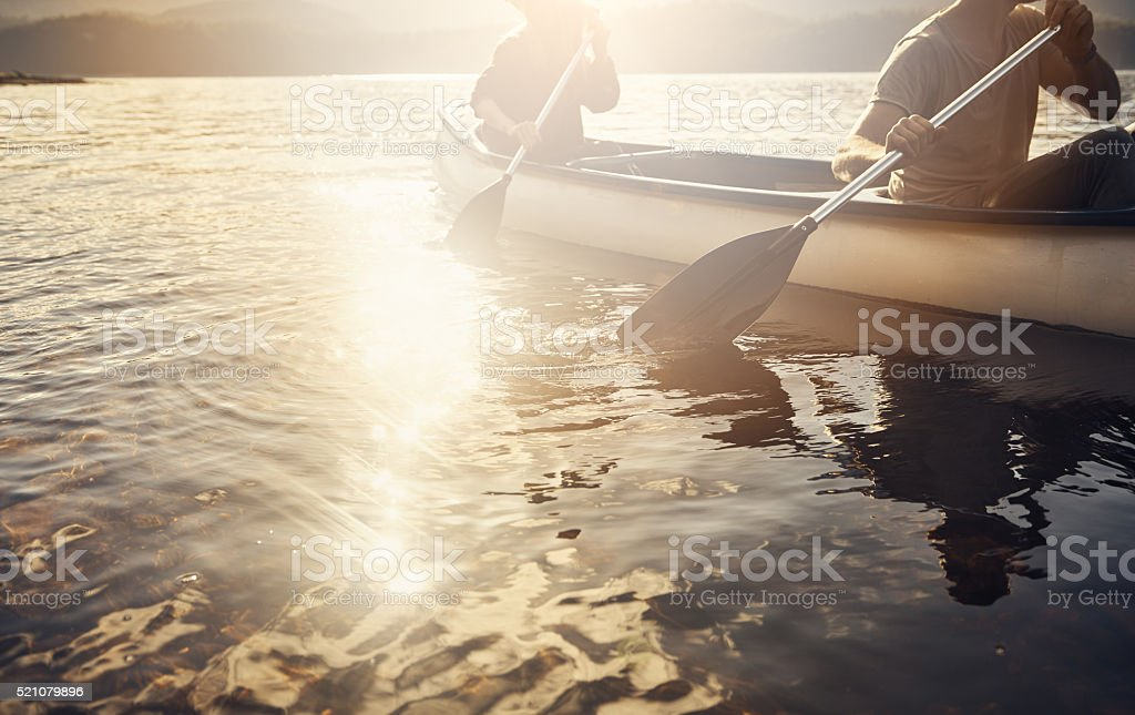 Row ahead and make things happen stock photo