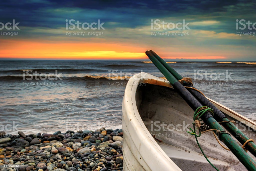 Row boat at Playa Waikiki stock photo