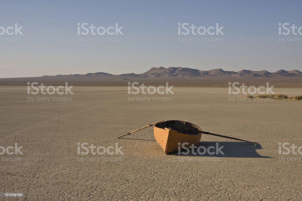 row boat in desert stock photo