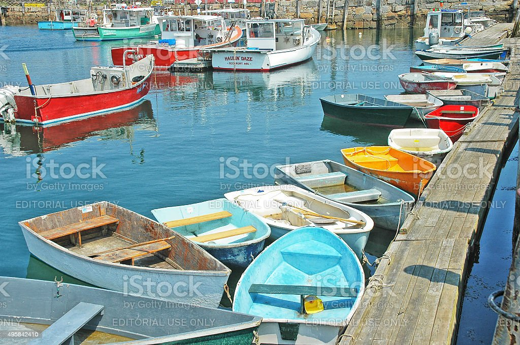 Row Boats in Rockport Massachusetts tied up to walkway stock photo