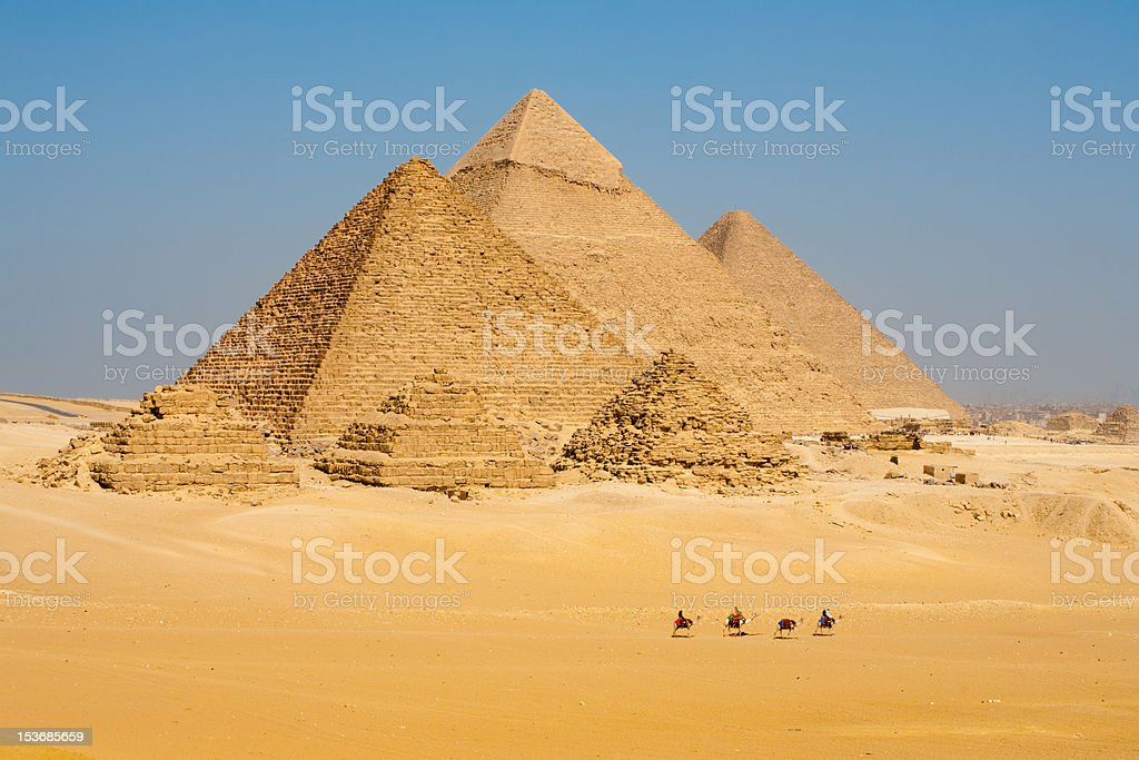 Row Camels Walk Pyramids Together royalty-free stock photo