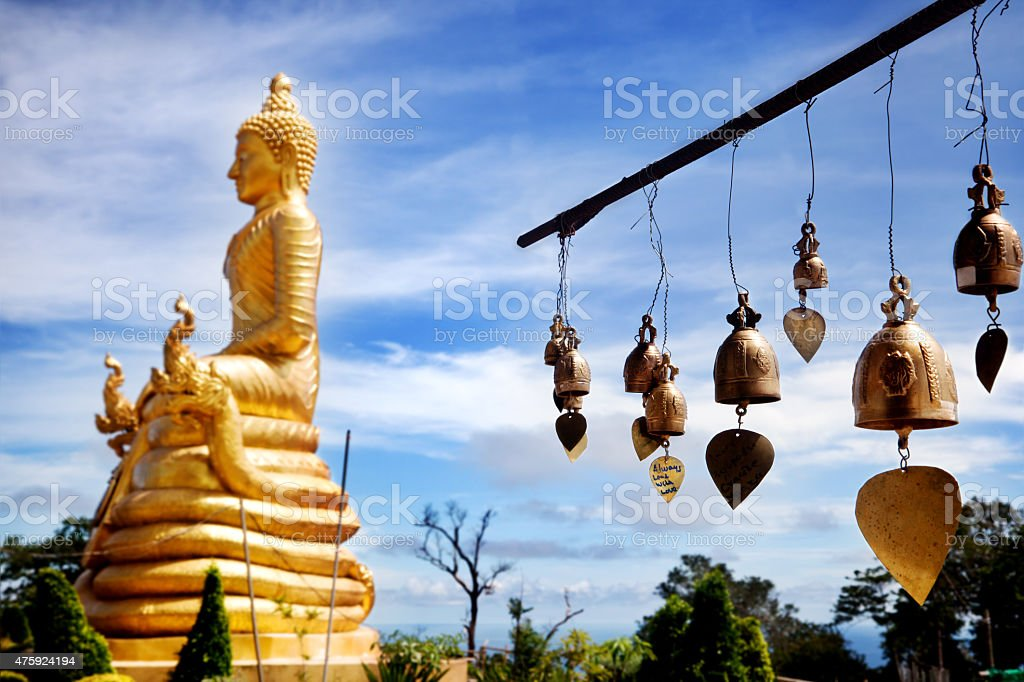 Row golden bells in buddhist temple. big buddha in Thailand. stock photo