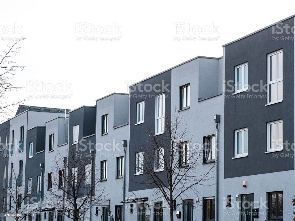 row houses in white and grey stock photo