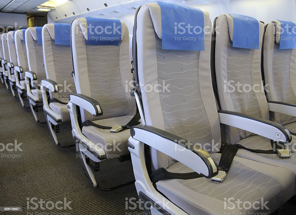 A row of airline seats in a plane stock photo