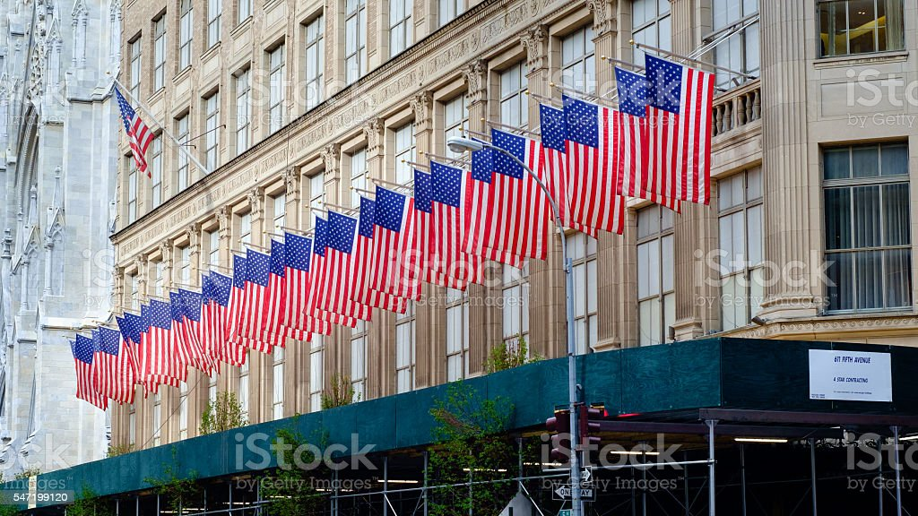 Row of American flags on Saks Fifth Avenue, New York stock photo