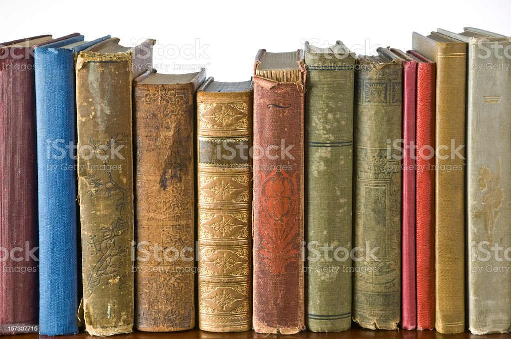 Row of antique books on a shelf stock photo