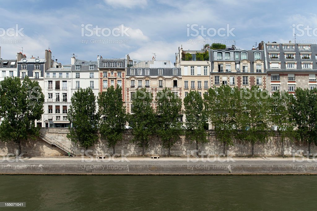 row of apartment buildings by a river royalty-free stock photo