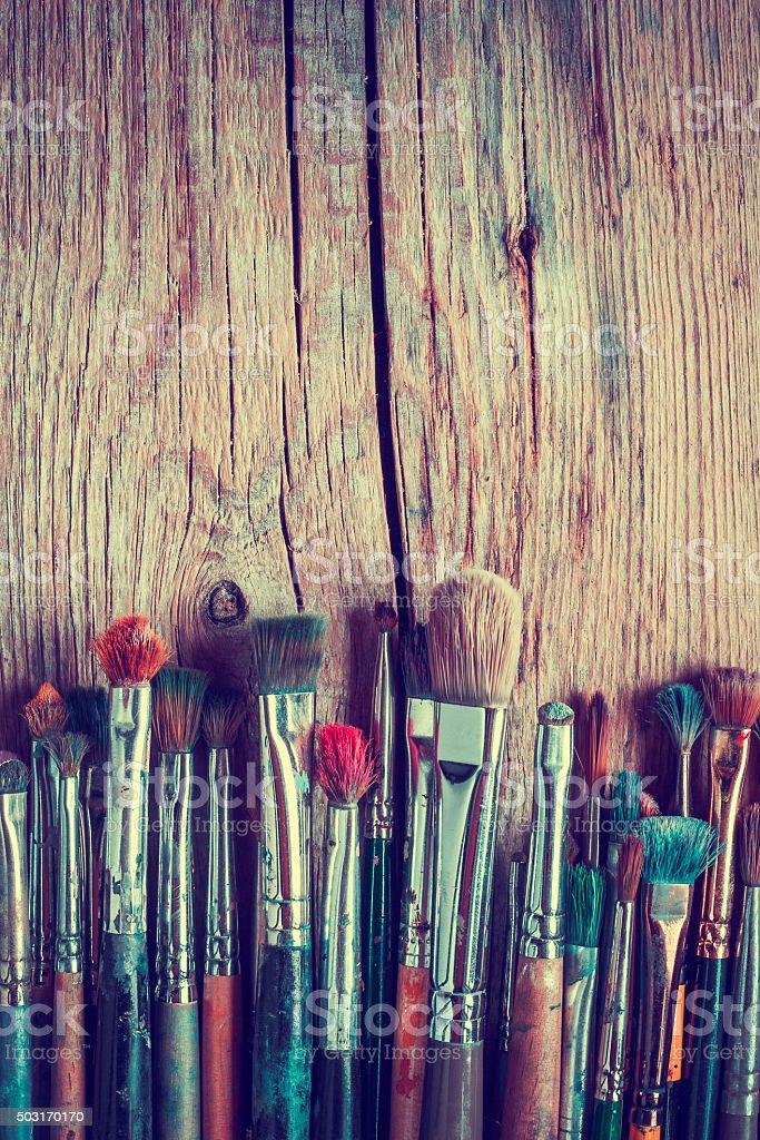 Row of artist paintbrushes closeup stock photo