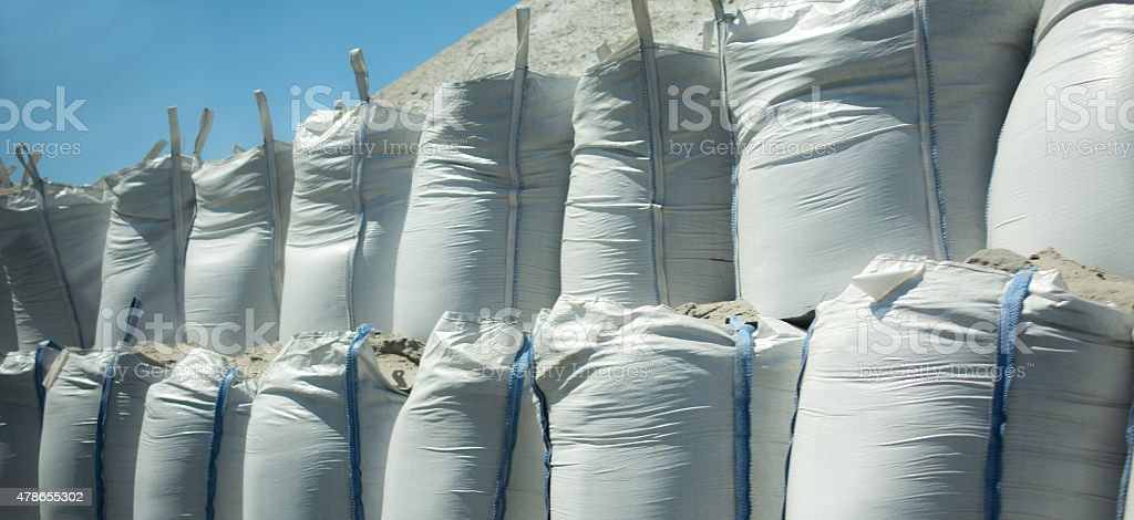 Row of ballast bags filled with sand stock photo