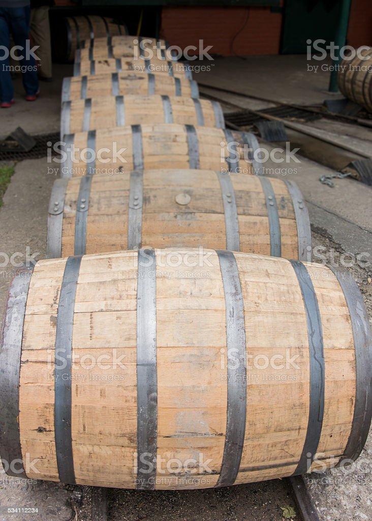 Row of Barrels Rolling Vertical stock photo