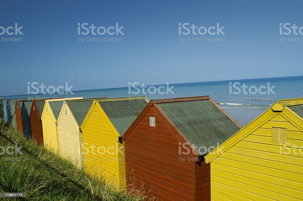 Row of beach huts against a blue sky royalty-free stock photo