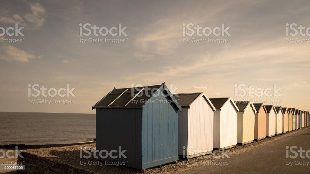 Row of beach huts at Felixstowe beach stock photo