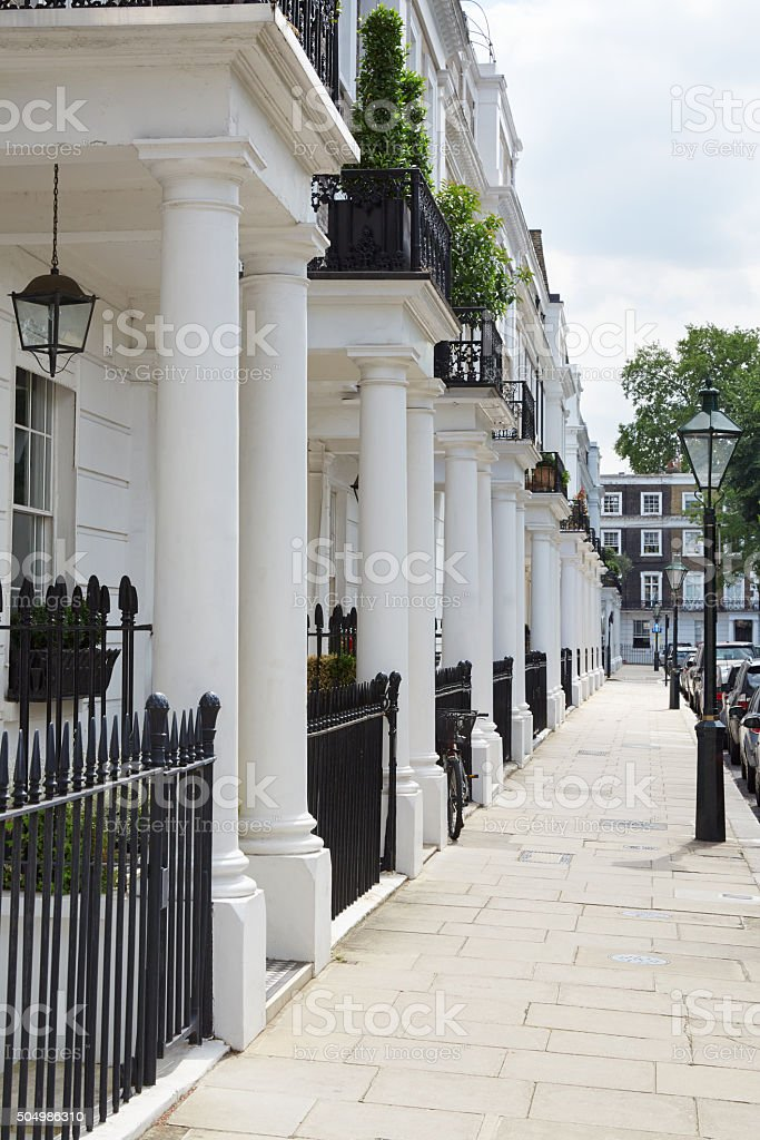 Row of beautiful white edwardian houses in London stock photo