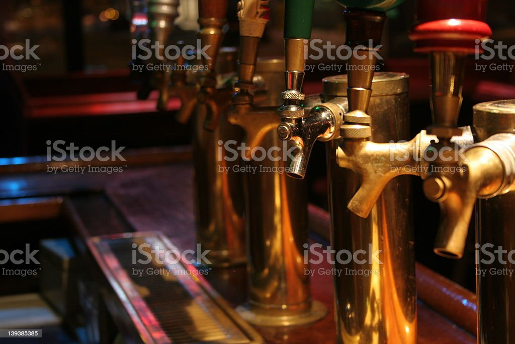 row of beer draft taps royalty-free stock photo