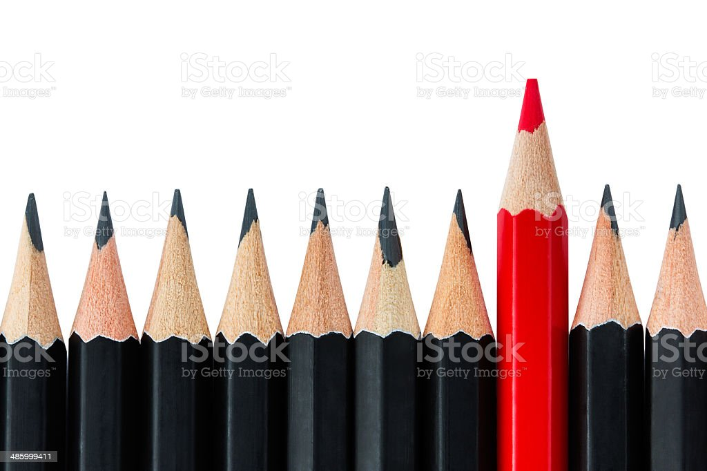 Row of black pencils with one red pencil in middle royalty-free stock photo
