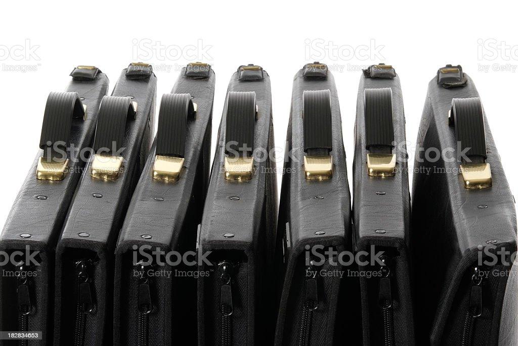 Row of black portfolio against white background royalty-free stock photo