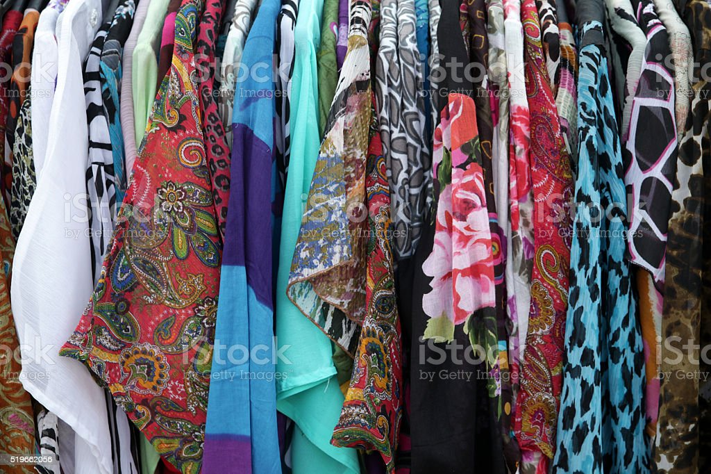 Row of blouses hanging in the wardrobe stock photo