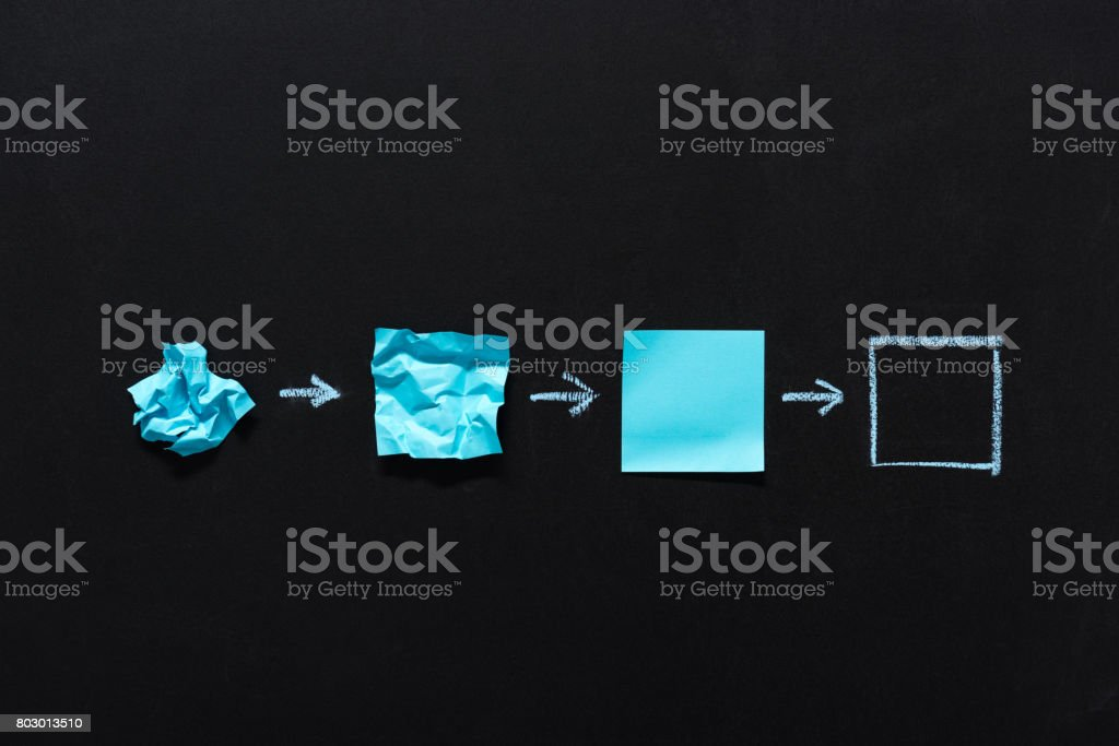 row of blue blank notes in different states isolated on black stock photo