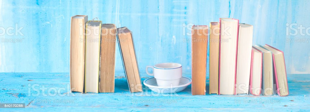 row of book, cup of coffee, stock photo