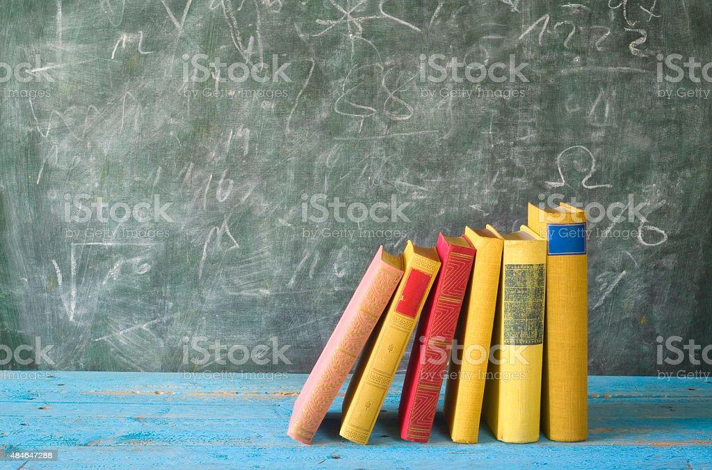 row of books, blackboard, education,concept stock photo