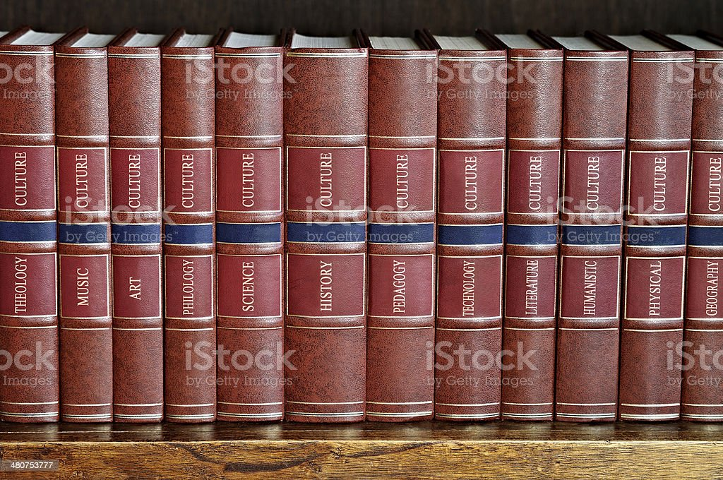 row of books on a shelf with titles in English stock photo