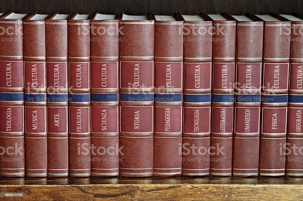 row of books on a shelf with titles in Italian stock photo