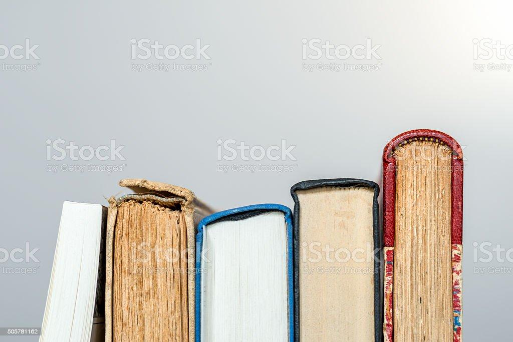 row of books on grey background stock photo