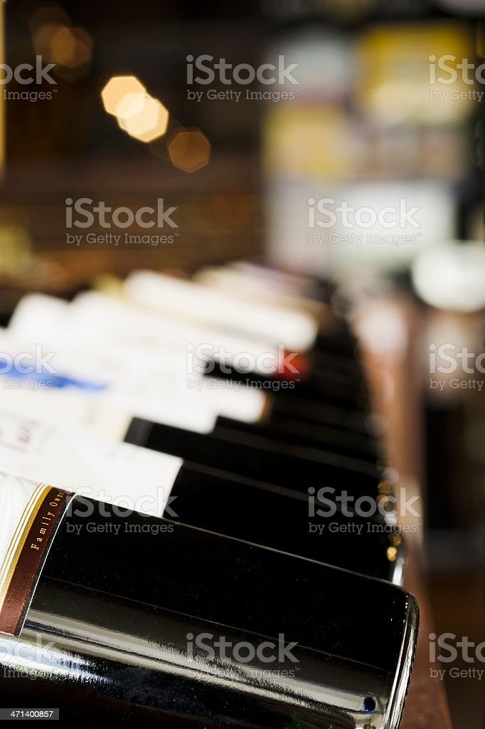 Row of Bottles on Display at the Wine Shop royalty-free stock photo