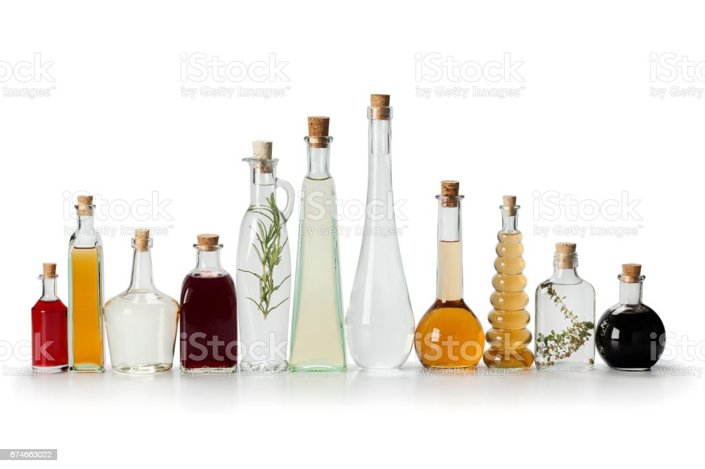 Row of bottles with vinegar stock photo