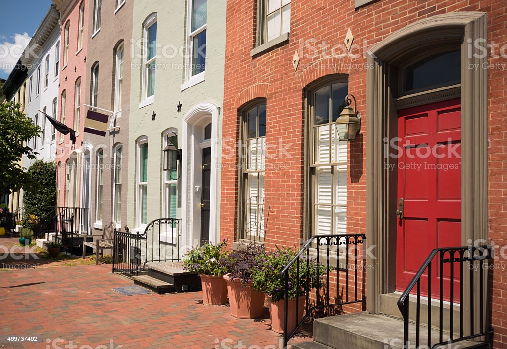 Row of brick houses on a residential street in Baltimore, MD stock photo
