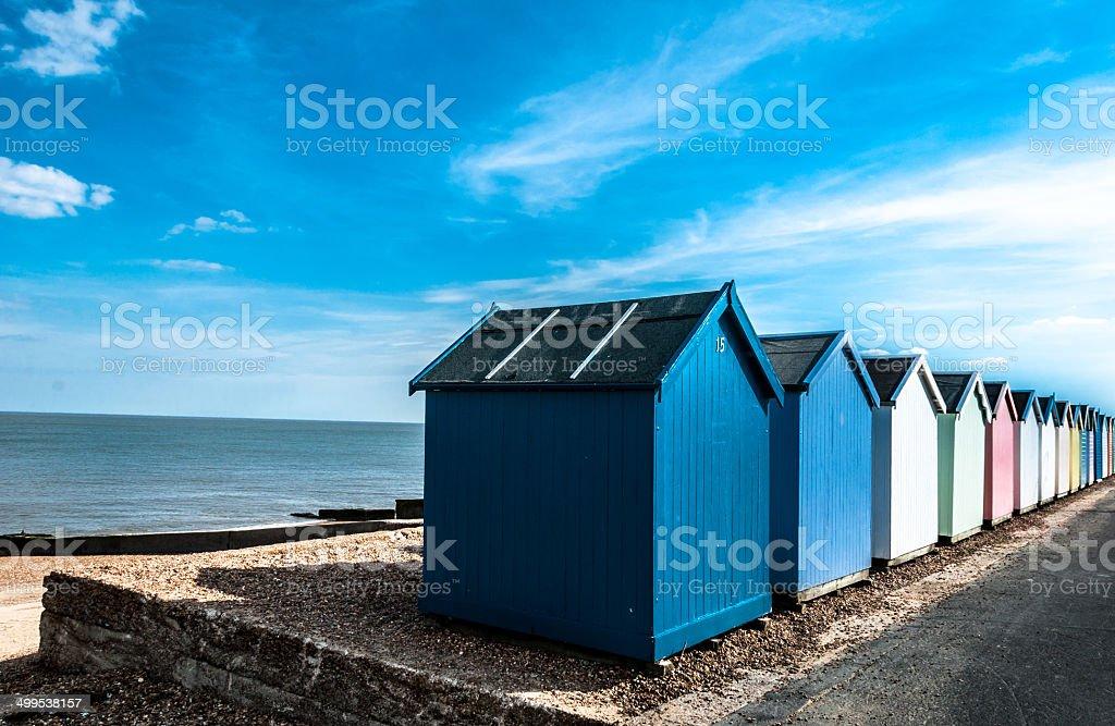 Row of Bright Beach Huts at Felixstowe, Suffolk, England, UK stock photo
