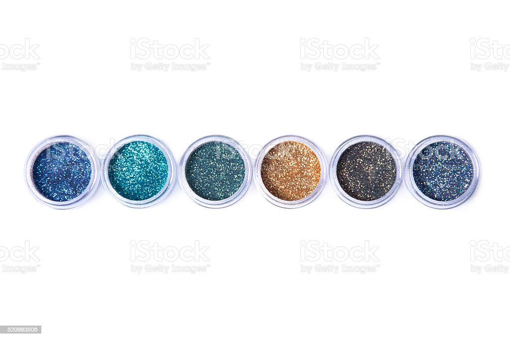 Row of bright glitters in transparent jars stock photo