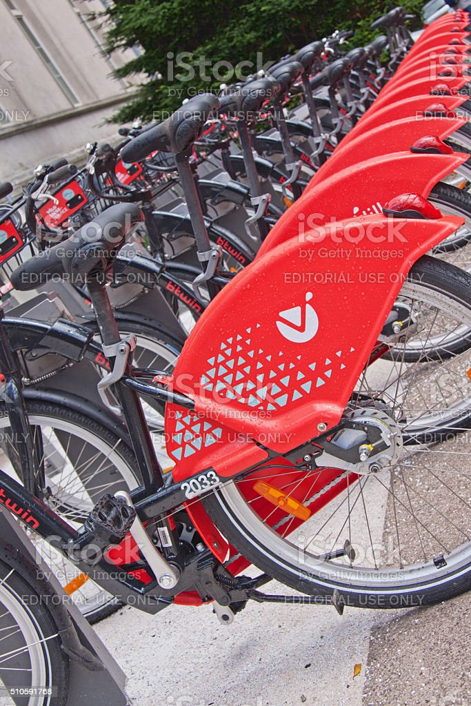 Row of bright red public bicycles in Lille, France stock photo