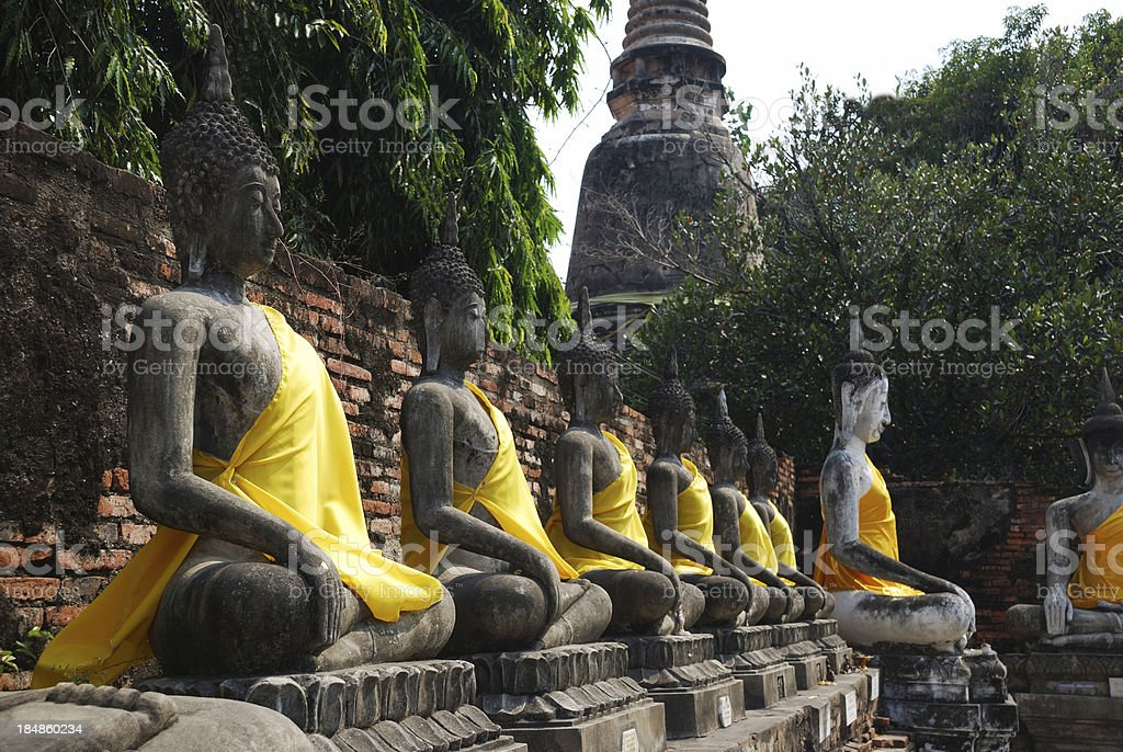 Row of Buddha sculptures in thai temple. royalty-free stock photo
