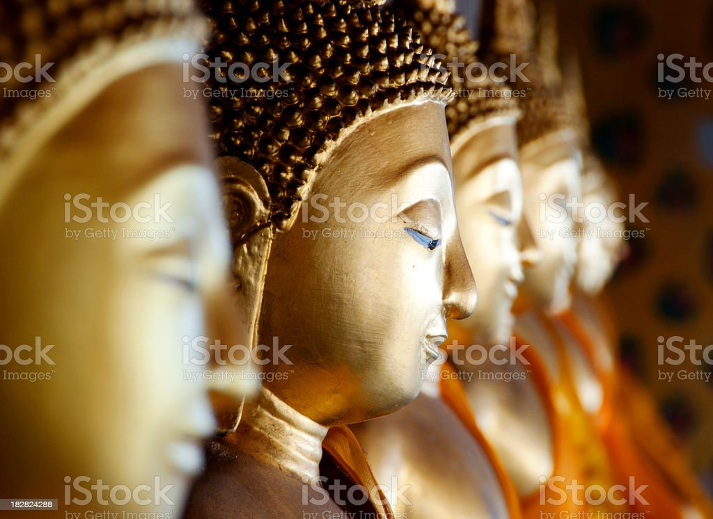 Row of Buddhas at Wat Arun, Bangkok, Thailand stock photo