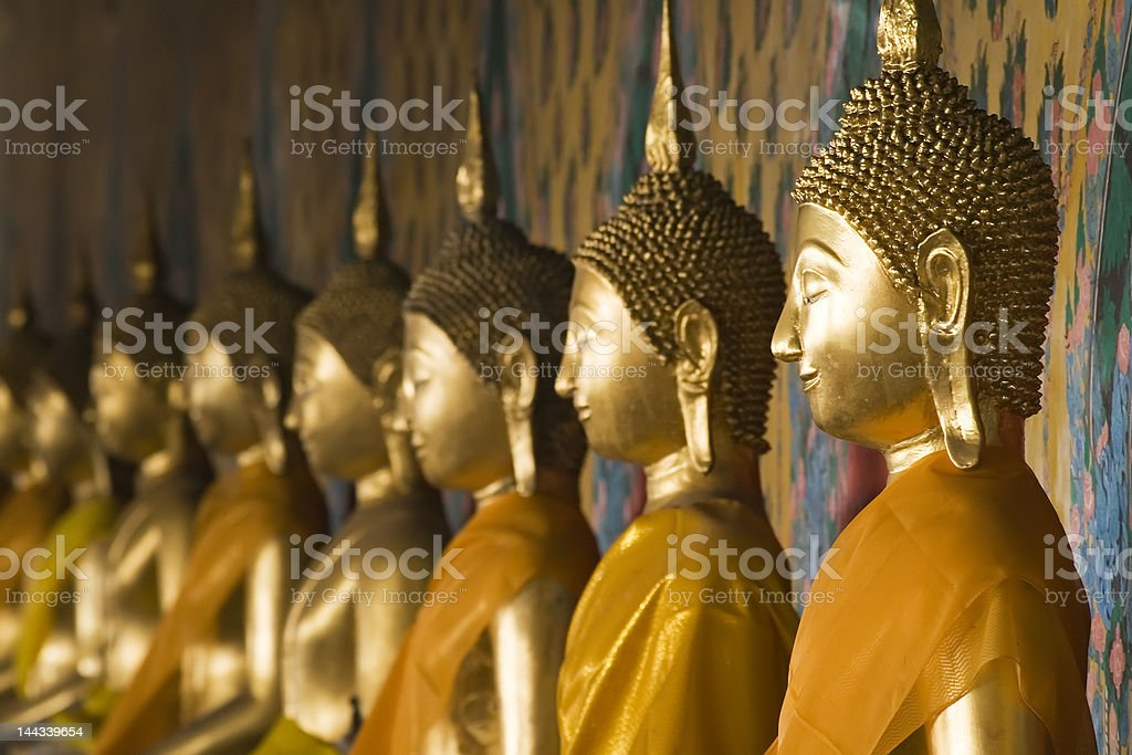 Row of Buddhas at Wat Arun in Bangkok, Thailand. stock photo