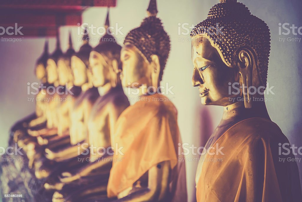 Row of Buddhas in a temple stock photo