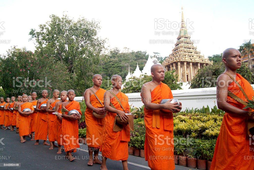 Row of Buddhist Monks on Phrabuddhabat Woramahavihan in Saraburi,Thailand. stock photo