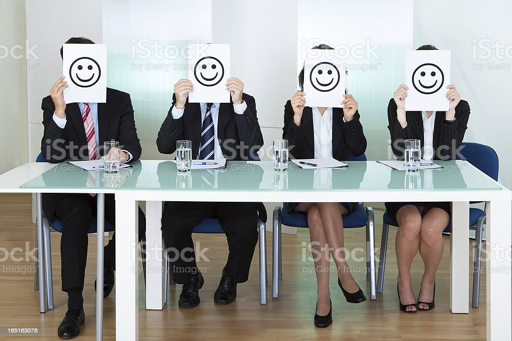Row of business executives with smiley faces stock photo