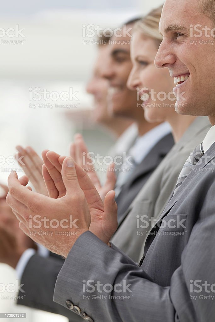 Row of business professionals clapping. royalty-free stock photo