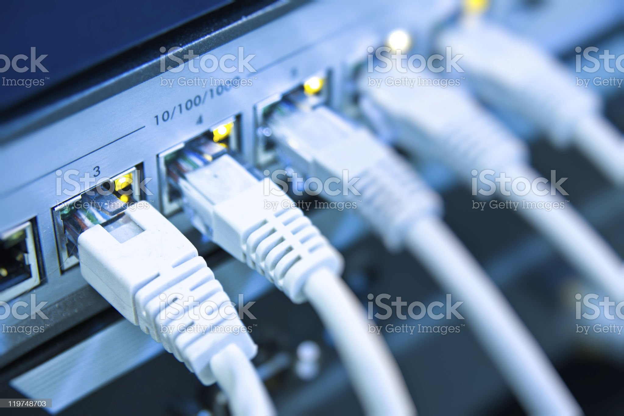 A row of cables attached to the back of a computer royalty-free stock photo