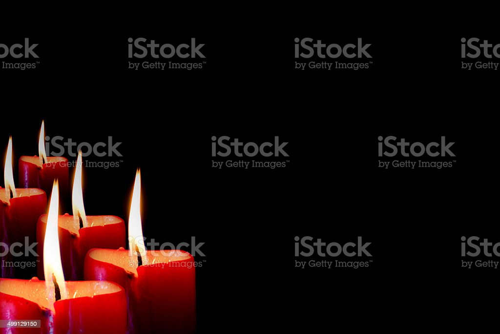 Row of Candle flame in black background stock photo