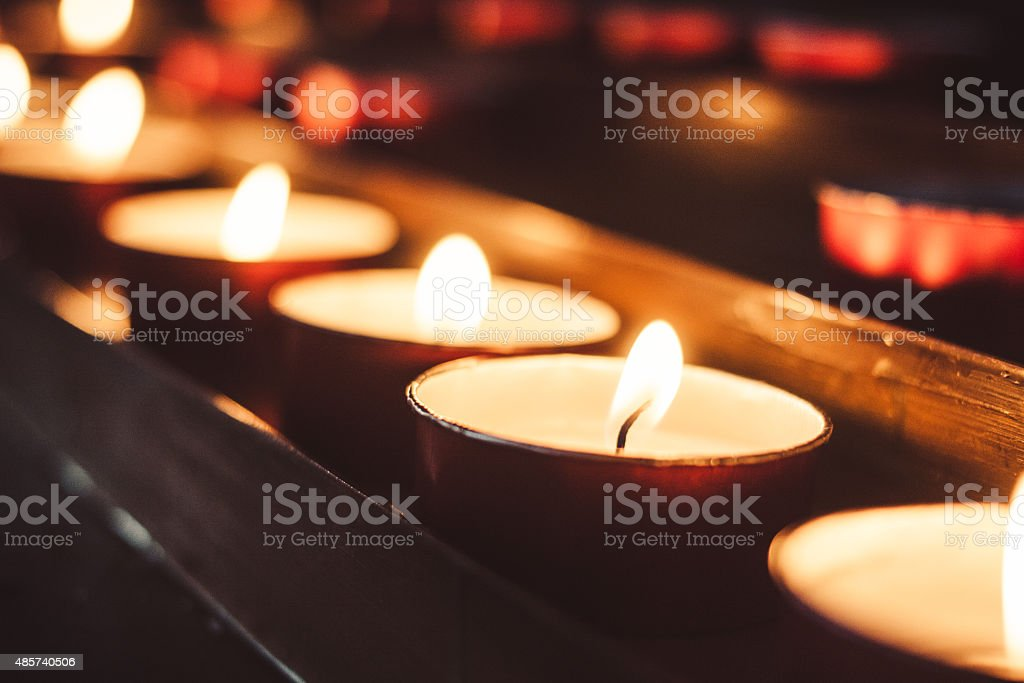row of candles stock photo