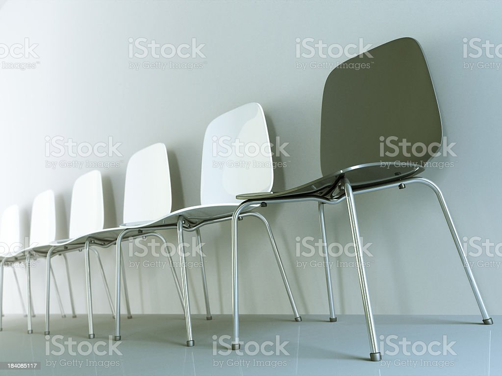 A row of chairs leaning against the wall stock photo